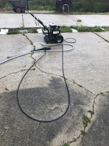 Concrete pressure washing progress