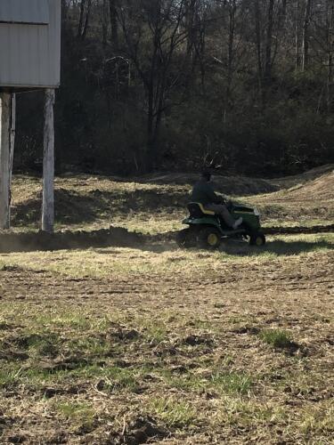 Volunteer mowing