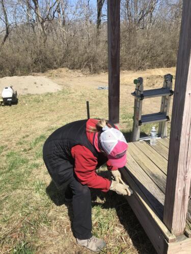 Volunteer preparing shelter for paint