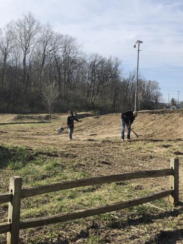 Volunteers leveling BMX track